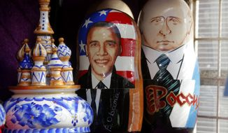 Traditional Russian matryoshka wooden dolls depicting President Obama and Russian President Vladimir Putin are on display in St. Petersburg on Friday, Sept. 6, 2013, during the G-20 summit of world leaders. (AP Photo/Dmitry Lovetsky)