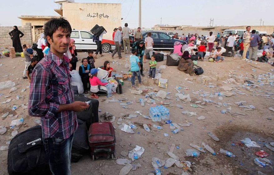 Refugees from Syria entering Iraq at Peshkhabour, August 19,2013  Associated Press photo
