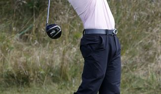 Zach Johnson watches his tee shot on the 14th hole during the final round of the BMW Championship golf tournament at Conway Farms Golf Club, Monday, Sept. 16, 2013, in Lake Forest, Ill. (AP Photo/Charles Rex Arbogast)
