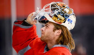Washington Capitals goalie Braden Holtby (70) gets ready for morning practice at Washington Capitals Training Camp at Kettler Capitals Iceplex, Arlington, Va., Monday, September 16, 2013. (Andrew Harnik/The Washington Times)
