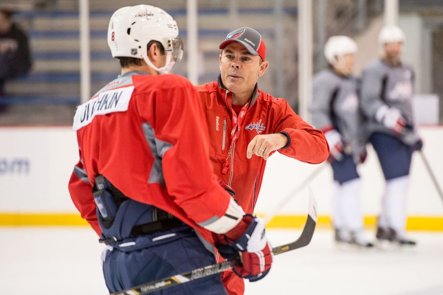Washington Capitals left wing Alex Ovechkin (8), left, talks with Washington Capitals Head Adam Oates, center, during morning practice at Washington Capitals Training Camp at Kettler Capitals Iceplex, Arlington, Va., Monday, September 16, 2013. (Andrew Harnik/The Washington Times)