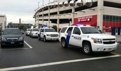 Families and law enforcement gather at Nationals Park near the Navy Yard. (Meredith Somers/The Washington Times)