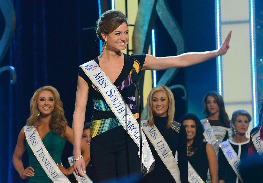 Miss South Carolina, Brooke Mosteller, waves during the preliminary competition of the Miss America pageant at Boardwalk Hall in Atlantic City, N.J., on Tuesday, Sept. 10, 2013. (AP Photo/The Press of Atlantic City, Ben Fogletto)