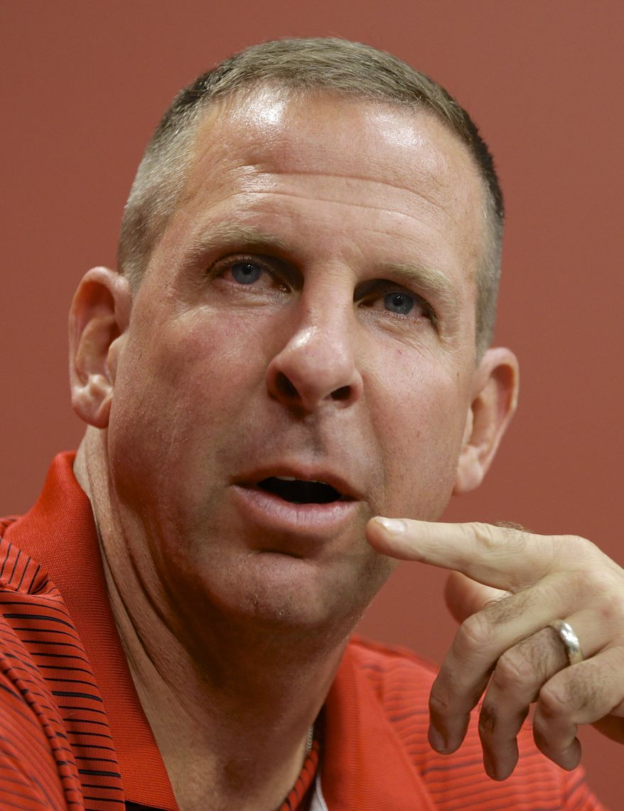 Nebraska head coach Bo Pelini speaks at a news conference in Lincoln, Neb., Monday, Aug. 26, 2013. No. 18 Nebraska's young defense will be tested right away when Wyoming brings its spread offense to Memorial Stadium for the opener. The Cornhuskers, with one returning starter in their first seven, will face one of the nation's top returning passers in Brett Smith. (AP Photo/Nati Harnik)