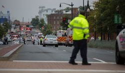 Swarms of police stand outside the Navy Yard as workers are evacuated from the area as police search for a gunman, in Washington, D.C., Monday, Sept. 16, 2013. (Andrew S. Geraci/The Washington Times) ** FILE **