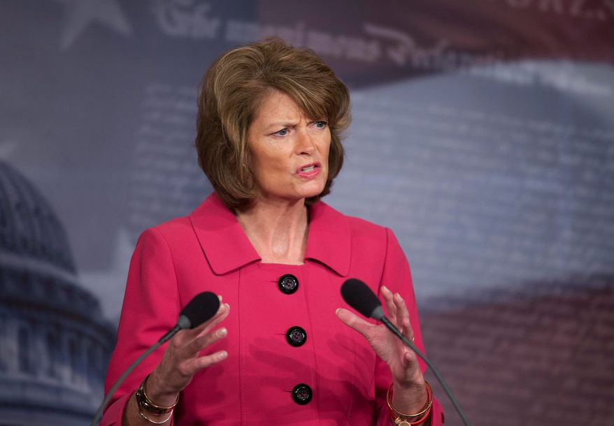 Sen. Lisa Murkowski, Alaska Republican, told Ron Binz at a confirmation hearing Tuesday she won't be able to vote for him to head the Federal Energy Regulatory Commission. Mr. Binz has sought the help of lobbyists and former lobbyists to win the post. (ASSOCIATED PRESS PHOTOGRAPHS)