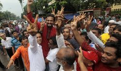 Bangladeshi activists shout slogans and celebrate the verdict against Jamaat-e-Islami party leader Abdul Quader Mollah in Dhaka, Bangladesh, on Sept. 17, 2013. Bangladesh's Supreme Court sentenced Mollah to death for committing crimes against humanity during the nation's 1971 independence war against Pakistan. (Associated Press)