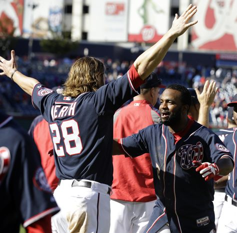Washington Nationals' Jayson Werth (28) celebrates with Denard Span (2) after their 6-5 win in the first baseball game of a doubleheader against the Atlanta Braves at Nationals Park Tuesday, Sept. 17, 2013, in Washington. Span drove in two-runs to win the game in the ninth inning on a fielding error by Braves shortstop Andrelton Simmons. (AP Photo/Alex Brandon)