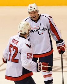 Washington Capitals' Mike Green bottom skates towards teammate Steven Oleksy as he celebrates his game-winning shoot-out goal against the Winnipeg Jets to win 4-3 preseason NHL hockey game on Saturday, Sept. 14, 2013, in Belleville, Ontario. (AP Photo/The Canadian Press, Sean Kilpatrick)