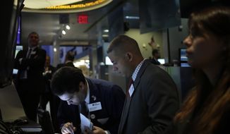 ** FILE ** In this Tuesday, Sept. 3, 2013, file photo, traders work on the floor at the New York Stock Exchange in New York. An Associated Press poll released Tuesday, Sept. 17, 2013, of more than two dozen economists suggests that global growth will remain below full health into 2014. (AP Photo/Seth Wenig, File)
