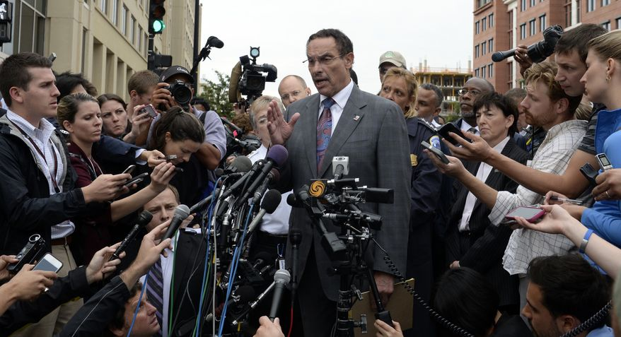District of Columbia Mayor Vincent Gray briefs reporters on the shooting at the Washington Navy Yard in Washington, Monday, Sept. 16, 2013. A gunman opened fire inside a building at the Washington Navy Yard on Monday morning. (AP Photo/Susan Walsh)