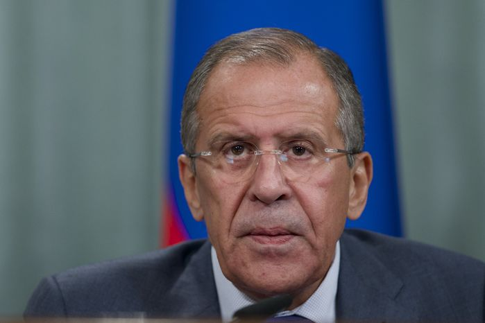Russian Foreign Minister Sergey Lavrov speaks during a news conference after his meeting with French counterpart Laurent Fabius, unseen, in Moscow, Russia, on Tuesday, Sept. 17, 2013. Moscow is insisting that a new United Nations resolution on Syria not allow the use of force, but Russia's foreign minister appears to suggest the issue could be reconsidered if Syria violates an agreement on abandoning its chemical weapons. (AP Photo/Ivan Sekretarev)