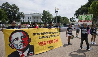 **FILE** Demonstrators rally in front of the White House in Washington on July 24, 2013, calling for immigration reform. The demonstrators urged President Obama to use executive authority to expand the policy that allowed hundreds of thousands of illegal immigrants who came to the United States as children to remain. (Associated Press)