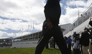 Tiger Woods walks off the 18th green after the final round of the BMW Championship golf tournament at Conway Farms Golf Club in Lake Forest, Ill., Monday, Sept. 16, 2013. (AP Photo/Charles Rex Arbogast)