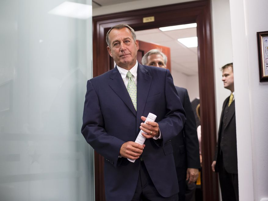 House Speaker John A. Boehner, Ohio Republican, and other House GOP leaders emerge from a closed-door strategy session at the Capitol in Washington on Wednesday, Sept. 18, 2013. House Majority Whip Kevin McCarthy, California Republican, follows Mr. Boehner. (AP Photo/J. Scott Applewhite)