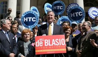 Democratic mayoral hopeful Bill de Blasio (center) speaks to reporters as City Council Speaker Christine Quinn (second from right) stands next to him during a news conference on Tuesday, Sept. 17, 2013, on the steps of City Hall in New York. Ms. Quinn endorsed Mr. de Blasio for mayor. He will face Republican nominee Joe Lhota in the Nov. 5 general election. (AP Photo/Mary Altaffer)