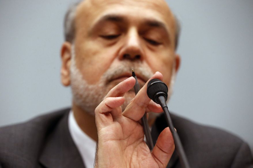 ** FILE ** In this Wednesday, July 17, 2013, file photo, Chairman of the Federal Reserve Ben Bernanke taps the microphone, as he testifies before the House Financial Services Committee on Capitol Hill in Washington. Economists and global investors expect the Fed to take its first step toward slowing the economic stimulus on Wednesday, Sept. 18, 2013. (AP Photo/Charles Dharapak, File)