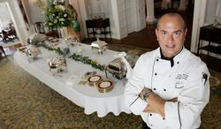 In this July 14, 2010 photo, Executive chef Todd Schneider poses in the dining room of the Executive Mansion in Richmond, Va. Schneider the former chef at Virginia's executive mansion has been indicted on four felony counts of embezzlement. Todd Schneider was arrested Thursday, March 27, 2012 by Virginia State Police on the indictments handed up last week in Richmond Circuit Court. (AP Photo/Richmond Times-Dispatch, Joe Mahoney)