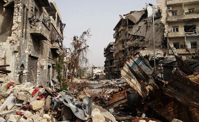Heavy fighting between government forces and Free Syrian Army fighters in Aleppo has left the city in ruins. (Associated Press Photographs)
