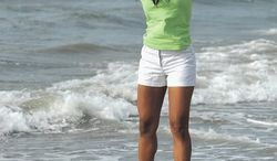 Miss America 2014 Nina Davuluri poses for photographers during the traditional dipping of the toes in the Atlantic Ocean the morning after being crowned Miss America, Monday, Sept. 16, 2013, in Atlantic City, N.J. Davuluri represented New York. (AP Photo by Michael Ein/The Press of Atlantic City)