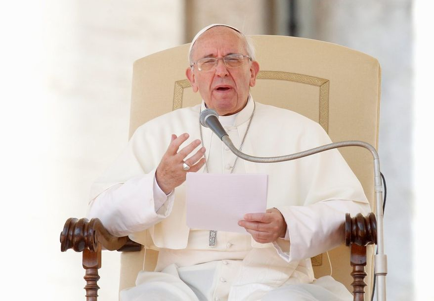 """Referring specifically to abortion, gay marriage and contraceptive use, Pope Francis said, """"it is not necessary to talk about these issues all the time."""" He said, """"The proclamation of the saving love of God comes before moral and religious imperatives."""" (ASSOCIATED PRESS)"""