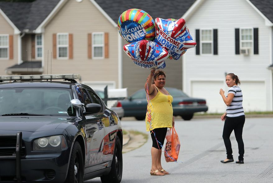 """Well wishers with """"Welcome Home"""" balloons head to 14-year-old Ayvani Hope Perez's family home in the Brookgate subdivision of Jonesboro, Ga., on Wednesday afternoon, Sept. 18, 2013, after police announced that she had been found. (AP Photo/Atlanta Journal-Constitution, Ben Gray)"""