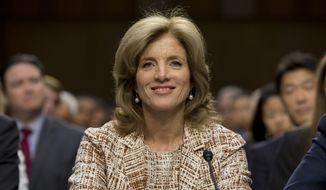 ** FILE ** Caroline Kennedy of New York looks to members of the Senate Foreign Relations Committee during a Sept. 19, 2013, hearing on Capitol Hill on her nomination for Ambassador to Japan. (Associated Press)
