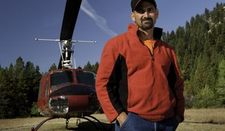 "William Bart Colantuono, a helicopter pilot who previously appeared in the History channel's ""Ax Men"" series, died on Tuesday, Sept. 17, 2013, when his chopper crashed while attempting to lift logs in an Oregon forest. (AP Photo/History)"
