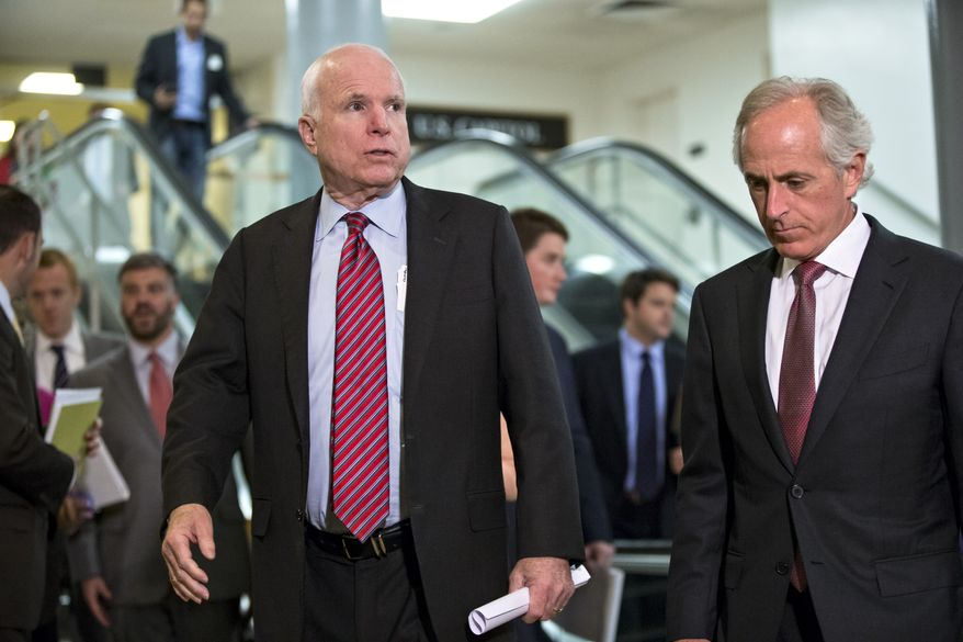 Sen. John McCain, R-Ariz., left, and Sen. Bob Corker, R-Tenn., right, members of the Senate Foreign Relations Committee, walk to a closed-door briefing on Syria with Secretary of State John Kerry, at the Capitol in Washington, Tuesday, Sept. 17, 2013. (AP Photo/J. Scott Applewhite)