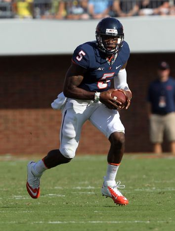 Virginia quarterback David Watford (5) runs with the ball during an NCAA college football game against Oregon, Saturday, Sept. 7, 2013, in Charlottesville, Va. Oregon defeated Virginia 59-10. (AP Photo/Andrew Shurtleff)
