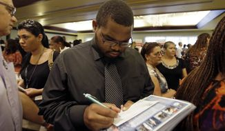 Job seeker Kelsey Devoe of Miramar, Fla., fills out a contact form at a job fair in Miami Lakes, Fla., on  Wednesday, Aug. 14, 2013. (AP Photo/Alan Diaz)