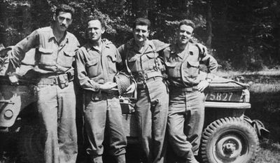 """J.D. Salinger (far left) is shown with fellow World War II counterintelligence officers in archival material obtained and used by director Shane Salerno in """"Salinger."""" (WEINSTEIN COMPANY VIA ASSOCIATED PRESS)"""