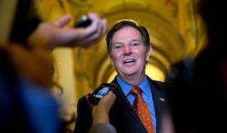 ** FILE ** Former House Majority Leader Tom DeLay talks to reporters as he leaves a lunch meeting on Capitol Hill, Thursday, Sept. 19, 2013, in Washington. A Texas appeals court tossed the criminal conviction of DeLay on Thursday, Sept. 19, 2013, saying there was insufficient evidence for a jury in 2010 to have found him guilty of illegally funneling money to Republican candidates. (AP Photo/Carolyn Kaster)