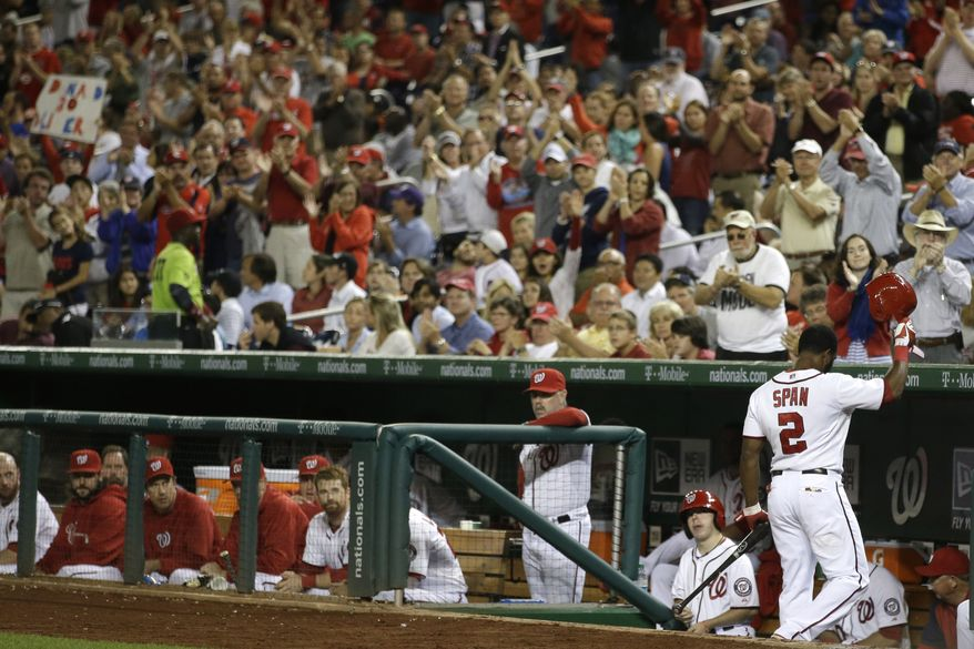Washington Nationals center fielder Denard Span tips his cap to the fans as they give him an ovation following his fourth at-bat. Span's 29-game hitting streak was snapped on Thursday. (Associated Press photo)