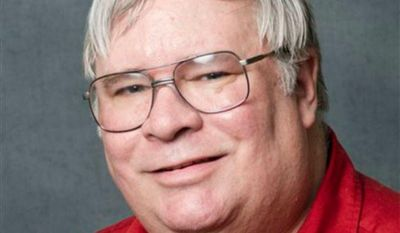"""Professor David Guth has been placed on leave because of a tweet he published after this week's mass shooting in Washington, the University of Kansas said Friday, Sept. 20, 2013. Guth tweeted """"blood is on the hands of the #NRA. Next time, let it be YOUR sons and daughters."""" (AP Photo/University of Kansas, Chuck France)"""