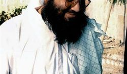 ** FILE **  The Taliban's then-Foreign Minister Wakil Ahmed Muttawakil in Kandahar, Afghanistan is seen in this March 4, 2001 photo. Muttawakil, who served as foreign minister when the Taliban ruled Afghanistan, hailed Pakistan's release of Mullah Abdul Ghani Baradar, the Taliban's former deputy leader, on Saturday, Sept. 21, 2013. (AP Photo/Kamal Khan, File)