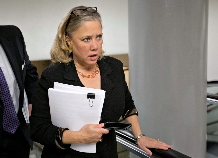 Sen. Mary L. Landrieu, Louisiana Democrat, could be the swing vote in committee that decides the fate of Ron Binz, the president's nominee to be chairman of the Federal Energy Regulatory Commission. (Associated Press)