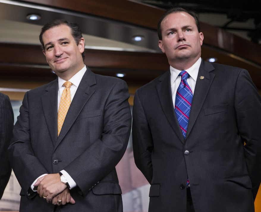 Republican Sens. Ted Cruz (left) of Texas and Mike Lee of Utah are pictured during a news conference with conservative congressional Republicans at the Capitol in Washington on Thursday, Sept. 19, 2013. (AP Photo/J. Scott Applewhite)