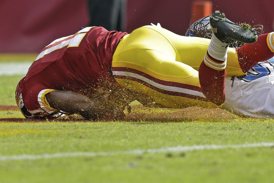 Washington Redskins wide receiver Aldrick Robinson looses control of the ball in the end zone after pullin in a pass from Robert Griffin III during the second half of a NFL football game against the Detroit Lions in Landover, Md., Sunday, Sept. 22, 2013. Upon official revenue the pass as ruled incomplete. The Lions defeated the Redskins 27-20. (AP Photo/Alex Brandon)