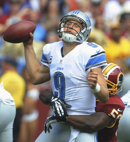 Detroit Lions quarterback Matthew Stafford is sacked by Washington Redskins inside linebacker London Fletcher during the first half of a NFL football game in Landover, Md., Sunday, Sept. 22, 2013. (AP Photo/Richard Lipski)