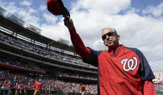 Washington National manager Davey Johnson tips his cap to the crowd before a baseball game against the Miami Marlins at Nationals Park in Washington, Sunday, Sept. 22, 2013. Johnson announced earlier in the season that this would be his last year managing the team. The Nationals organization paid tribute to him before the game, presenting him with a video tribute and a crystal award.  (AP Photo/Susan Walsh)