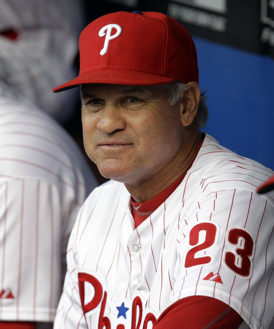 ADVANCE FOR WEEKEND EDITIONS, SEPT. 7-8 - FILE - In this Aug. 19, 2013,, file photo, Philadelphia Phillies interim manager Ryne Sandberg watches from the dugout during a baseball game in Philadelphia. Charlie Manuel is gone, replaced by Hall of Famer Ryne Sandberg. The Phillies are heading toward their first losing season since going 80-81 in 2002. (AP Photo/Laurence Kesterson)