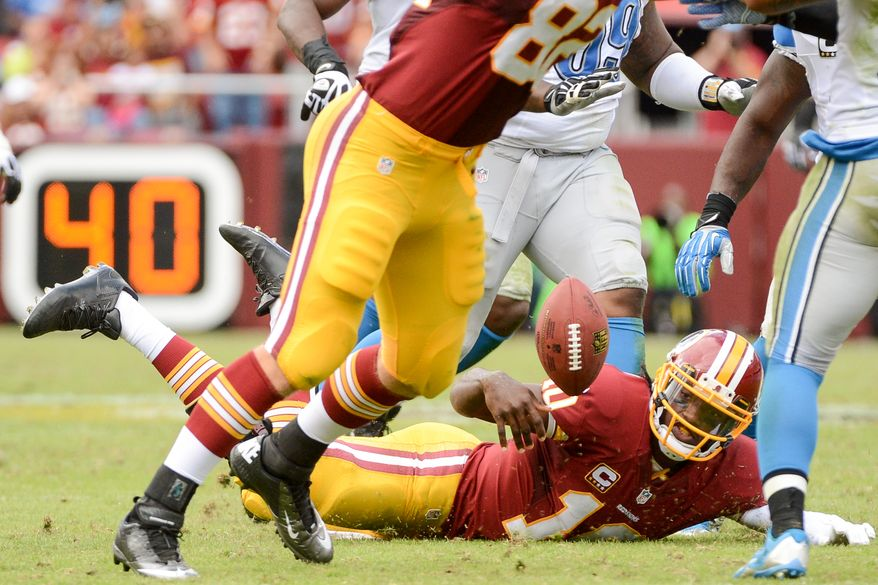 Washington Redskins quarterback Robert Griffin III (10) fumbles as he goes down after keeping the ball and rushing in the forth quarter as the  Washington Redskins play the Detroit Lions in NFL football at FedExField, Landover, Md., Monday, September 9, 2013. (Andrew Harnik/The Washington Times)