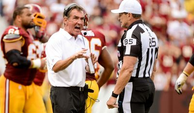 Washington Redskins head coach Mike Shanahan Argues with referee Ed Hockley after they rule that Washington Redskins quarterback Robert Griffin III (10) fumbled on a keeper run in the forth quarter as the  Washington Redskins play the Detroit Lions in NFL football at FedExField, Landover, Md., Monday, September 9, 2013. (Andrew Harnik/The Washington Times)