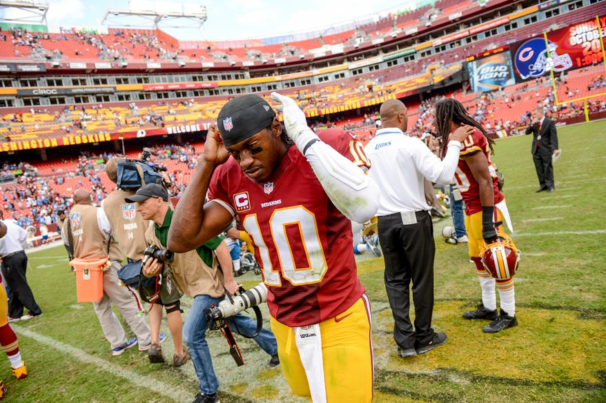 Washington Redskins quarterback Robert Griffin III (10) walks off the field as the Washington Redskins lose to the Detroit Lions 27-20 in NFL football at FedExField, Landover, Md., Monday, September 9, 2013. (Andrew Harnik/The Washington Times)