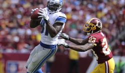 Detroit Lions wide receiver Calvin Johnson (81) hauls in a first down reception in front of Washington Redskins cornerback DeAngelo Hall (23) during first quarter action as the Washington Redskins play the Detroit Lions at FedExField, Landover, Md., September 22, 2013. (Preston Keres/Special for The Washington Times)