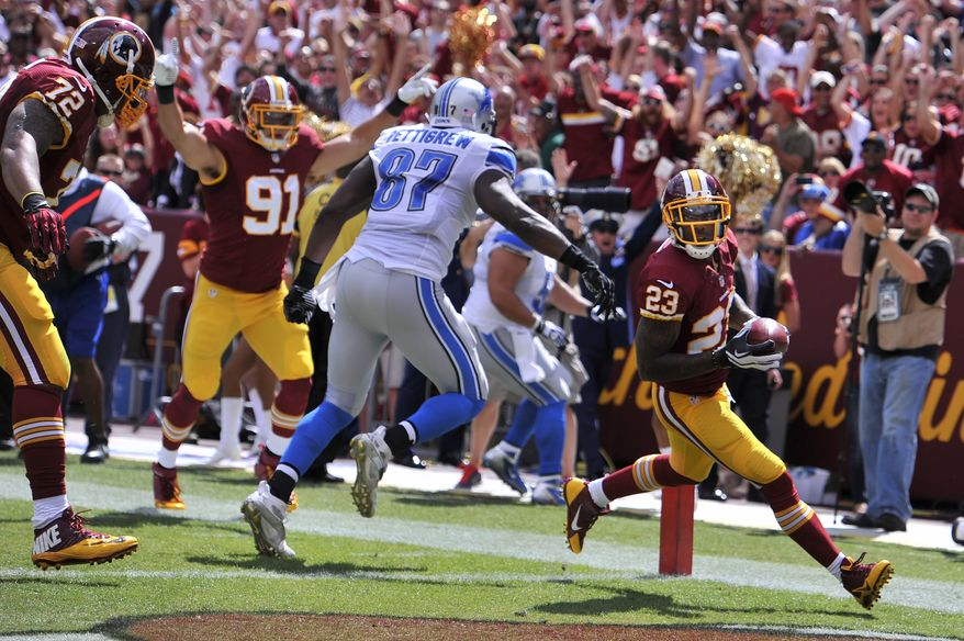 Washington Redskins cornerback DeAngelo Hall (23) intercepts a first quarter pass and runs in back 17 yards for the touchdown as the Washington Redskins play the Detroit Lions at FedExField, Landover, Md., September 22, 2013. (Preston Keres/Special for The Washington Times)