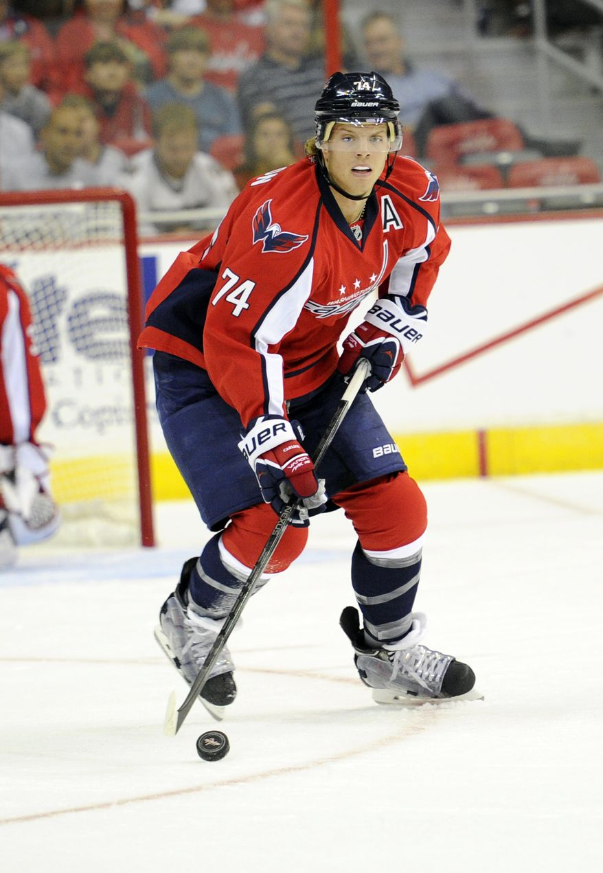Washington Capitals defenseman John Carlson (74) skates with the puck against the Chicago Blackhawks during the first period an NHL preseason hockey game, Friday, Sept. 20, 2013, in Washington. (AP Photo/Nick Wass)