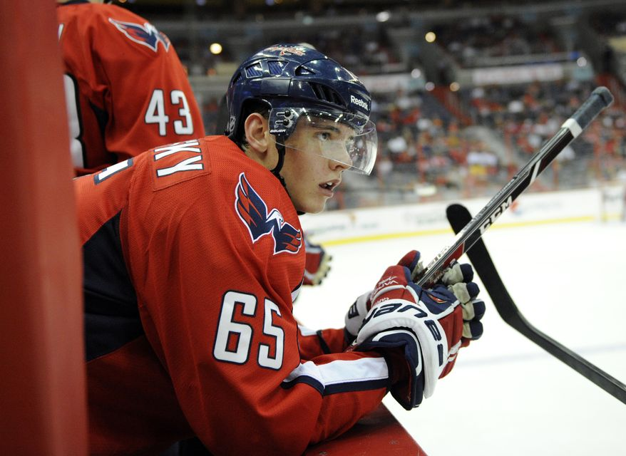 Washington Capitals left wing Andre Burakovsky (65), of Austria, looks on during the first period an NHL preseason hockey game against the Chicago Blackhawks, Friday, Sept. 20, 2013, in Washington. (AP Photo/Nick Wass)