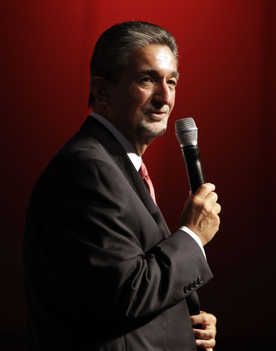 Washington Capitals majority owner Ted Leonsis speaks during the team's Capitals Convention, Saturday, Sept. 21, 2013, in Washington. Leonsis announced that the team will host the NHL's annual Winter Classic outdoor hockey game on New Year's Day in 2015. (AP Photo/Luis M. Alvarez